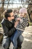 Father and daughter in autumn garden — Stock Photo