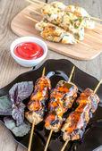 Grilled chicken skewers with herbs and spicy sauce — Stock Photo
