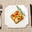 Portion of lasagna on the square plate — Stock Photo #57483777