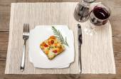 Portion of lasagna on the wooden table — Stock Photo