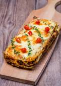Lasagna on the wooden board — Stock Photo
