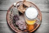 Slices of french Saucisson sausage with glass of beer — Stock Photo