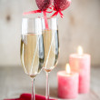 Glasses of champagne in candlelit on St Valentine's day — Stock Photo #59396845