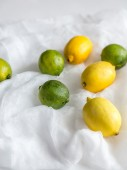 Lemons and limes on the white background — Stock Photo