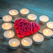 Heart with burning candles on the wooden background — Stock Photo #60008821
