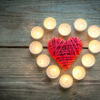 Heart with burning candles on the wooden background — Stock Photo #60008829