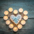 Heart with burning candles on the wooden background — Stock Photo #60009079