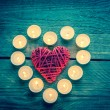 Heart with burning candles on the wooden background — Stock Photo #60009089
