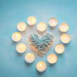 Heart with burning candles on the wooden background — Stock Photo #60009091