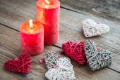 Hearts with burning candles on the wooden background — Stock Photo