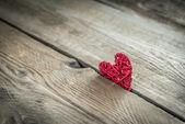 Handmade retro heart on the wooden background — Stock Photo