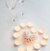 Two glasses with burning candles — Stock Photo