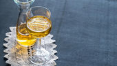 Glass of white wine in vintage decor — Stock Photo
