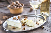 Brie cheese with nuts — Stock Photo