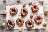 Donuts sprinkled with crushed nuts — Stock Photo