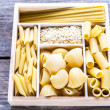 Various types of pasta in the wooden container — Stock Photo #64240525