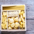Various types of pasta in the wooden container — Stock Photo #64240545