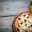 Cooked pizza with a glass of beer — Stock Photo #64711111