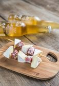 Camembert and salami  skewers — Stock Photo