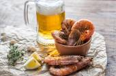 Fried shrimps with glass of beer — Stock Photo