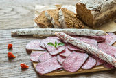 Salami with bread — Stock Photo