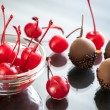 Chocolate and cocktail cherries on the glass — Stock Photo #73238075