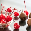 Chocolate and cocktail cherries on the glass — Stock Photo #74147481