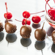 Chocolate and cocktail cherries — Stock Photo #74560117