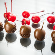 Chocolate and cocktail cherries — Stock Photo #74560141