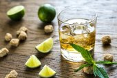 Glass of rum on the wooden background — Stock Photo