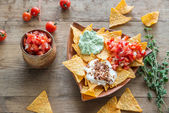 Cheese nachos with different types of sauce — Stock Photo