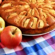 Freshly baked apple pie with apples in the background. — Stock Photo #72935159