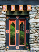 Bhutan traditional wooden decoration in rock wall — Stock Photo