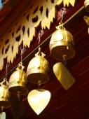 Golden bells in Buddhist place of worship in Chiang mai, Thailan — Stock Photo