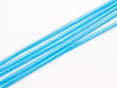 Light blue straws isolated on white back ground — Stock Photo
