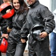 Girl and guy getting ready to race karts — Stock Photo #52438987