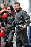 Girl and guy getting ready to race karts — Stock Photo