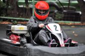 The young girl driving kart in Moscow — Stock Photo