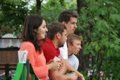 A group of young people watching the races karts — Stock Photo