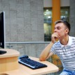 The young guy at the computer while working — Stockfoto #54895495