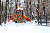 Children's playground in winter park — Stock Photo