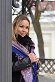 Girl with long blond hair in a bright scarf while walking around Moscow — Стоковое фото
