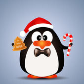 Penguin with Candy cane at Christmas — Stock Photo