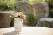 Artificial flowers in a vase — Stock Photo