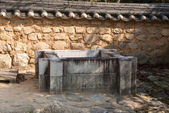 Square shaped stone well — Stock Photo