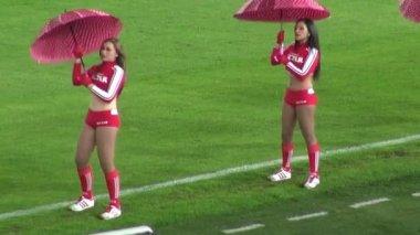 Cheerleaders, Talent, Performers, Red Umbrellas — Stock Video