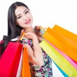 Young woman with shopping bags over white background — Stock Photo #52890891