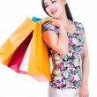 Young woman with shopping bags over white background — Stock Photo #52890899