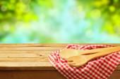 Kitchen utensil over garden bokeh background — Stock Photo
