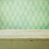 Retro classical wallpaper and wooden table — Stock Photo